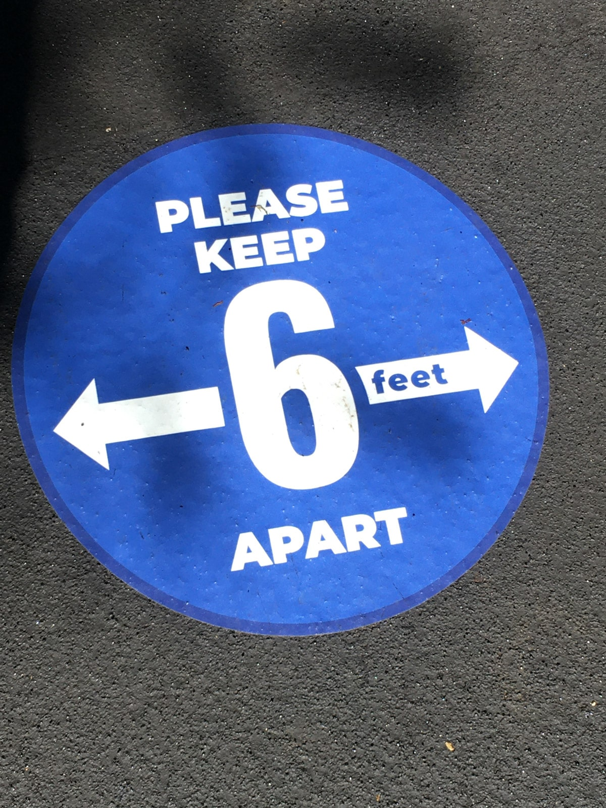 Six feet apart sticker at Silver Dollar City