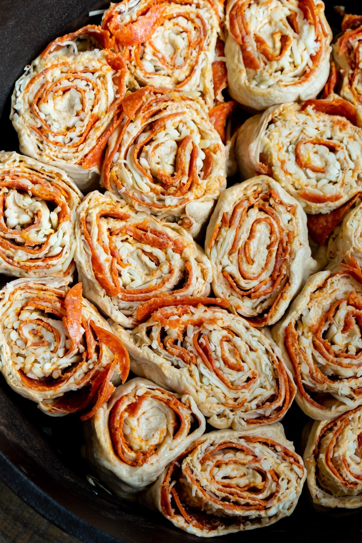 Uncooked pepperoni rolls in a dutch oven