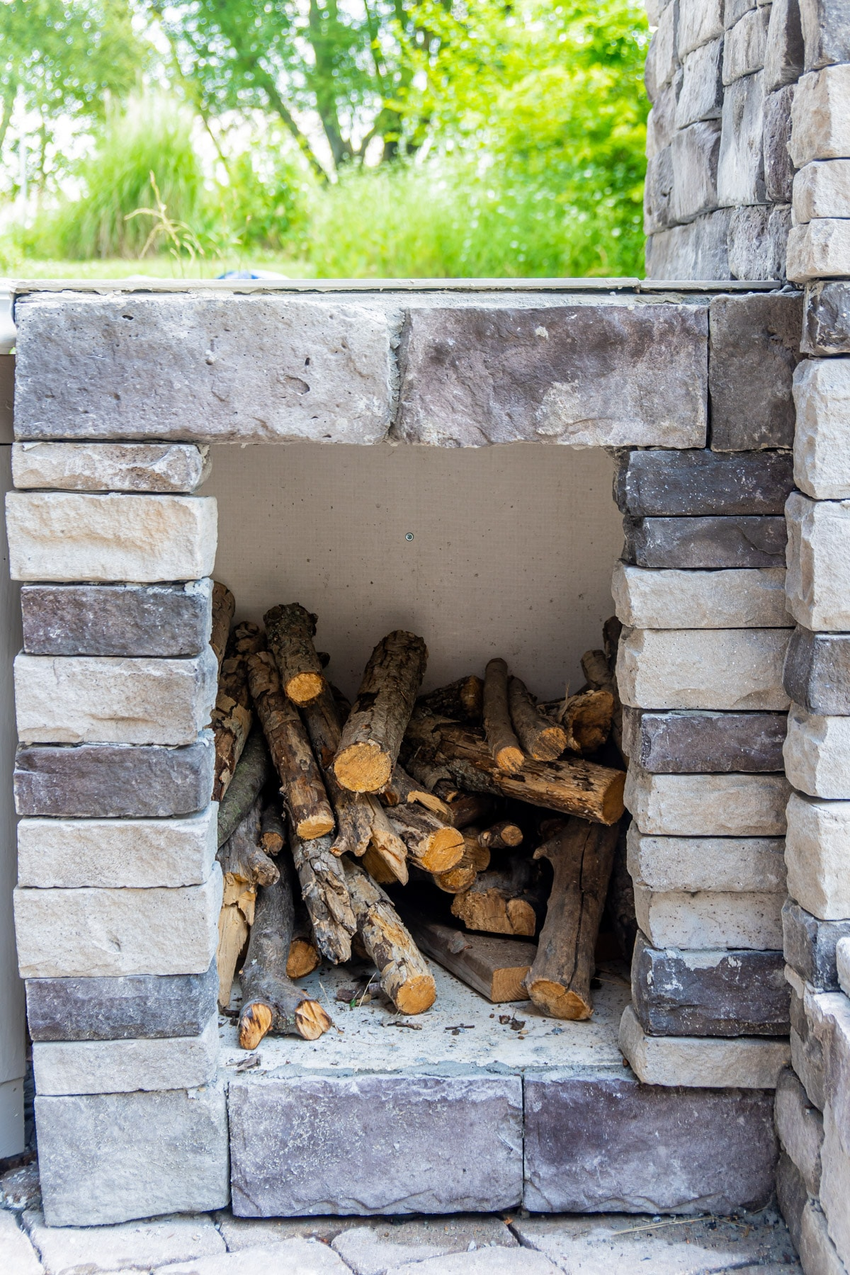 Stoned wood box for a backyard brick oven