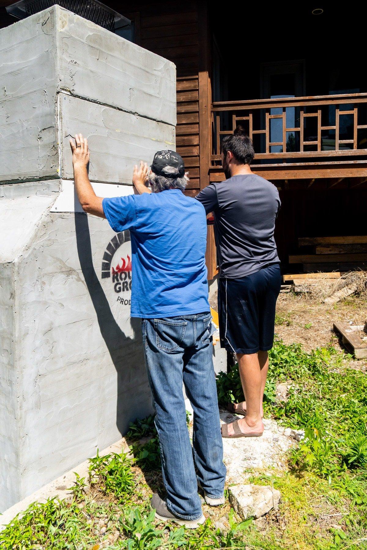 Adding drywall to back of backyard brick oven