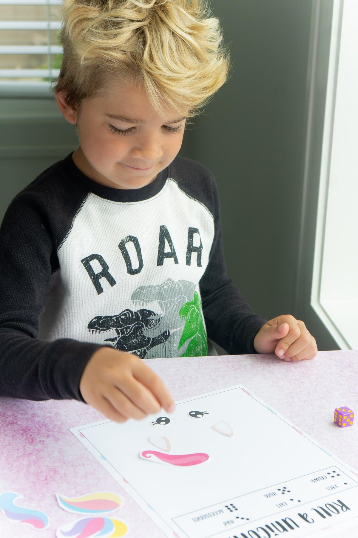 Boy playing roll a unicorn game