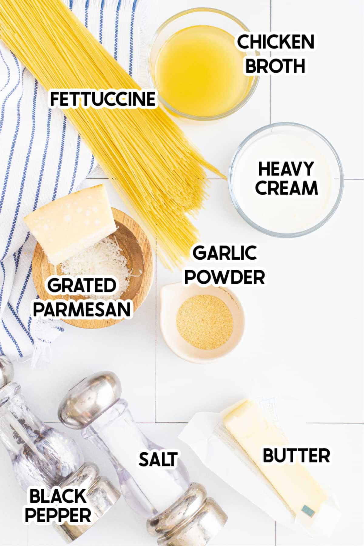 Pasta, cream, parmesan, and other ingredients for Instant Pot fettuccine alfredo