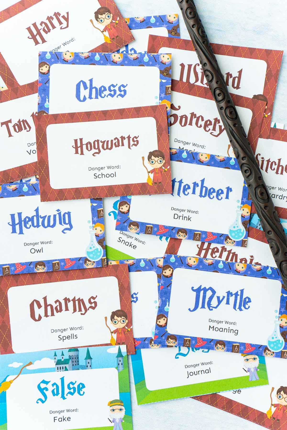 A bunch of little cards with Harry Potter words and pictures on them and a wand