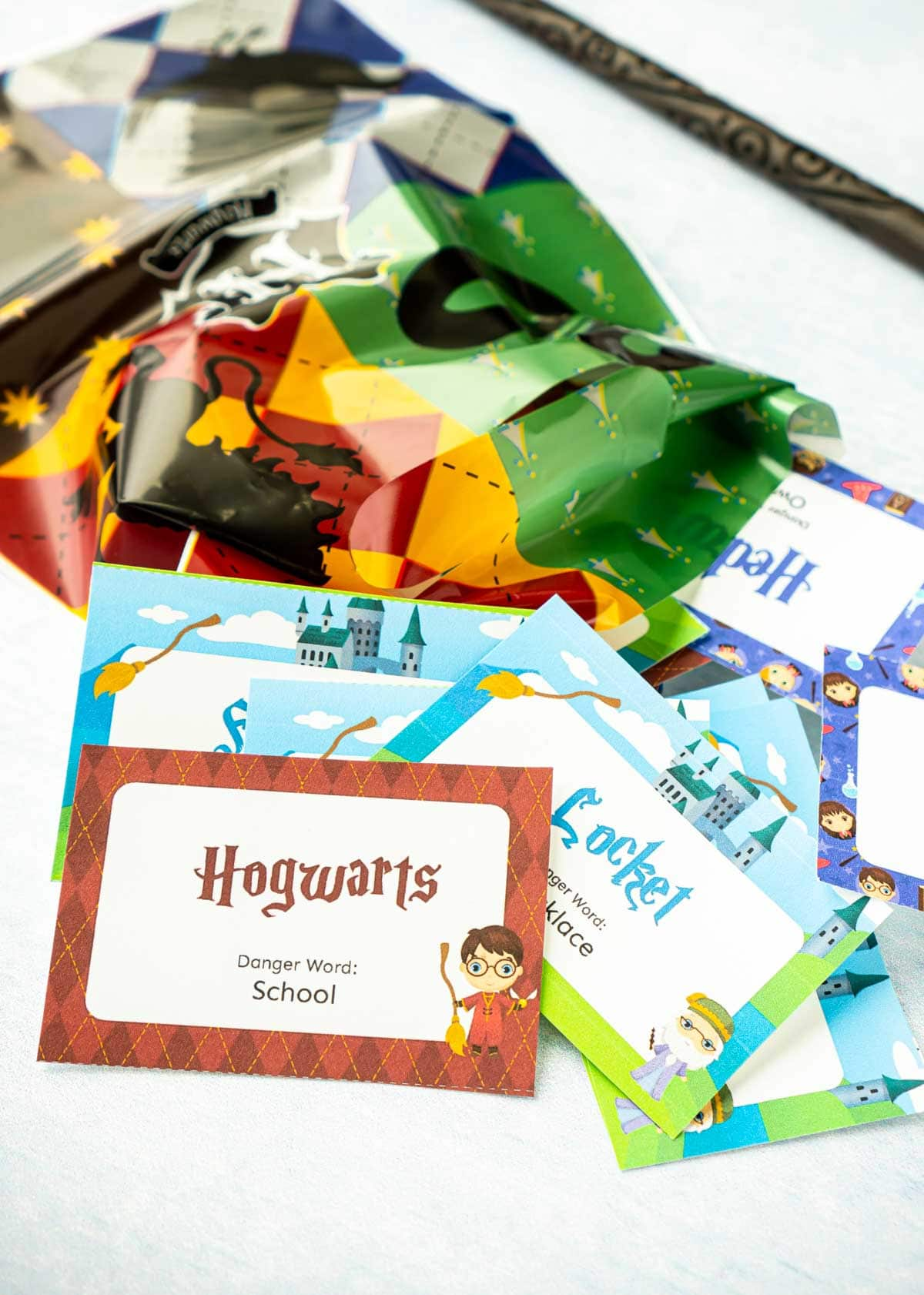 Small paper cards with Harry Potter phrases on them and a Harry Potter goodie bag