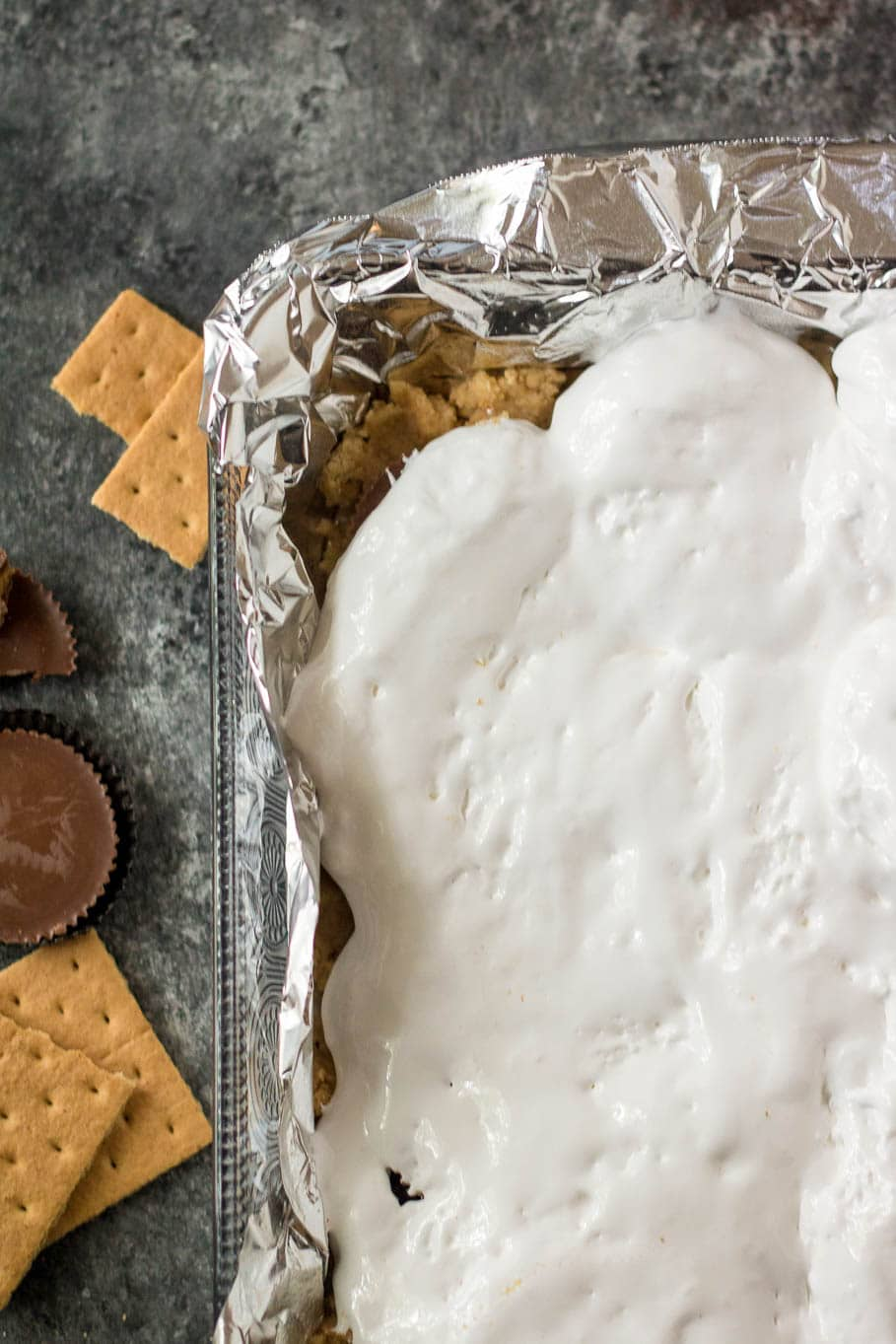 Marshmallow fluff in a baking dish with tin foil