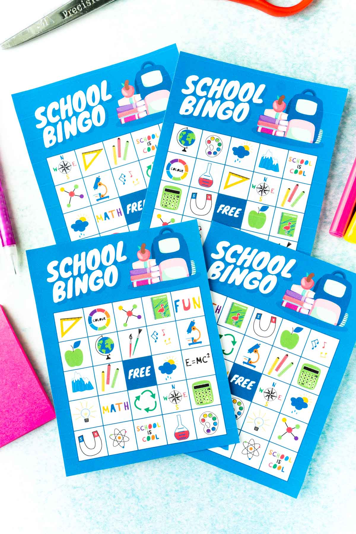 Four blue back to school bingo cards with school images on them