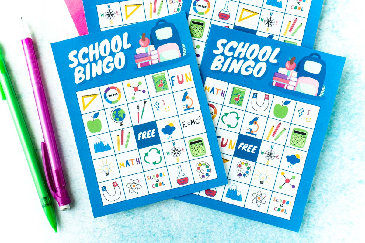 Four blue bingo cards with two pencils