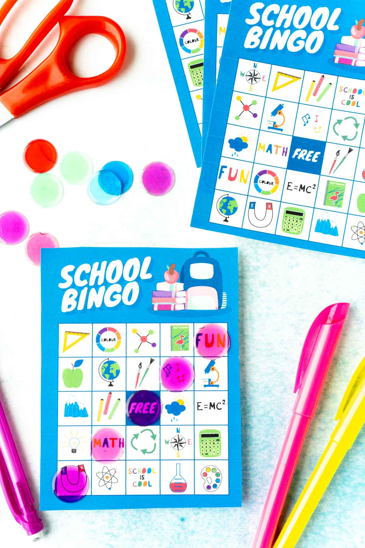 A blue school bingo card with school images on it