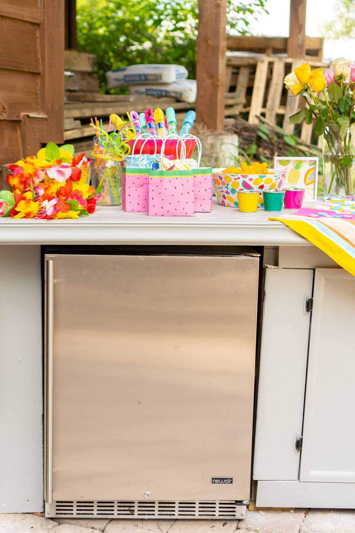 Newair beverage fridge and colorful party favors
