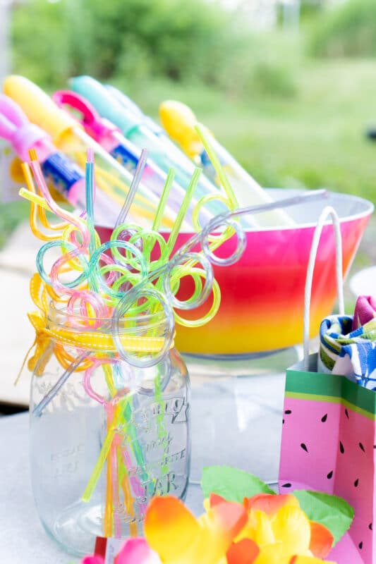 Crazy straws in a glass mason jar