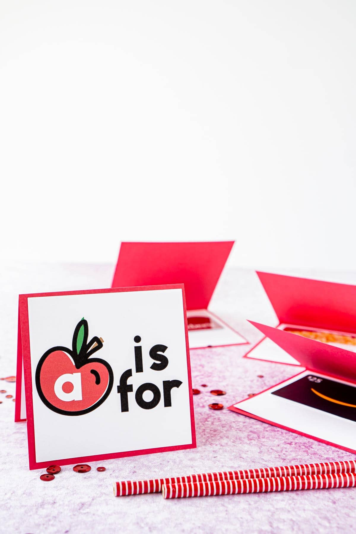A is for apple card with others laying down and open