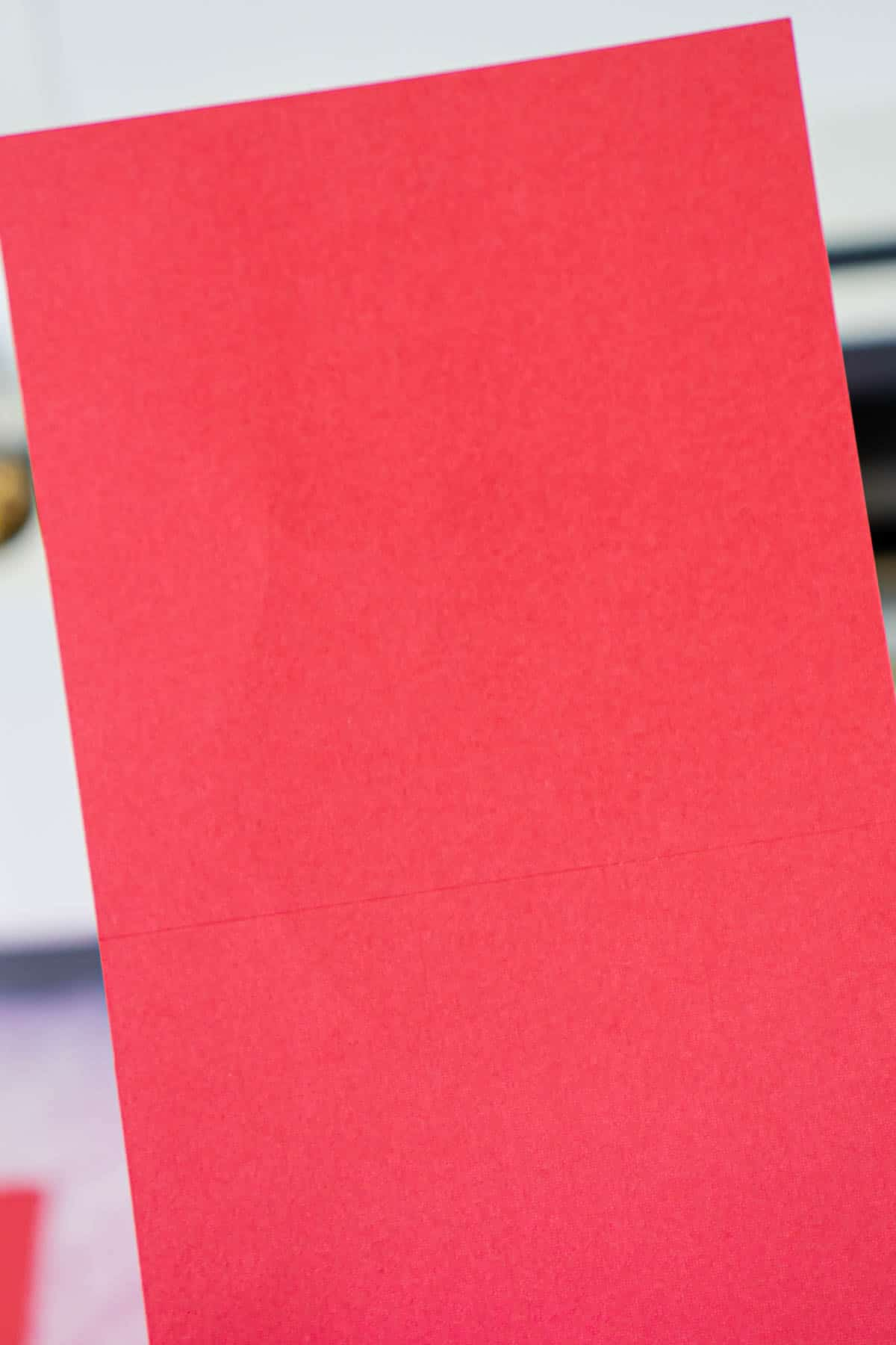 Piece of red cardstock with score lines
