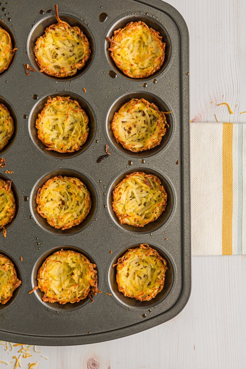 Browned hash brown cups in a muffin tin