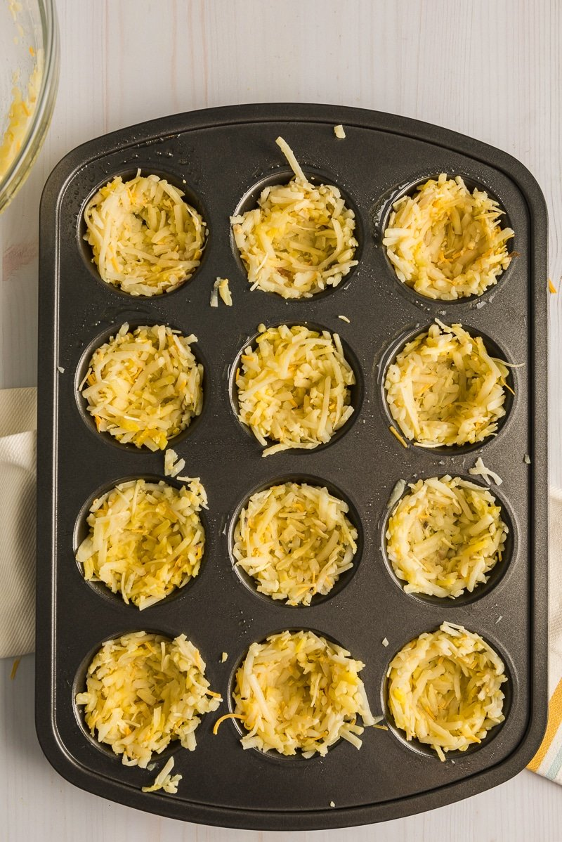 Hash brown mixture in muffin tins