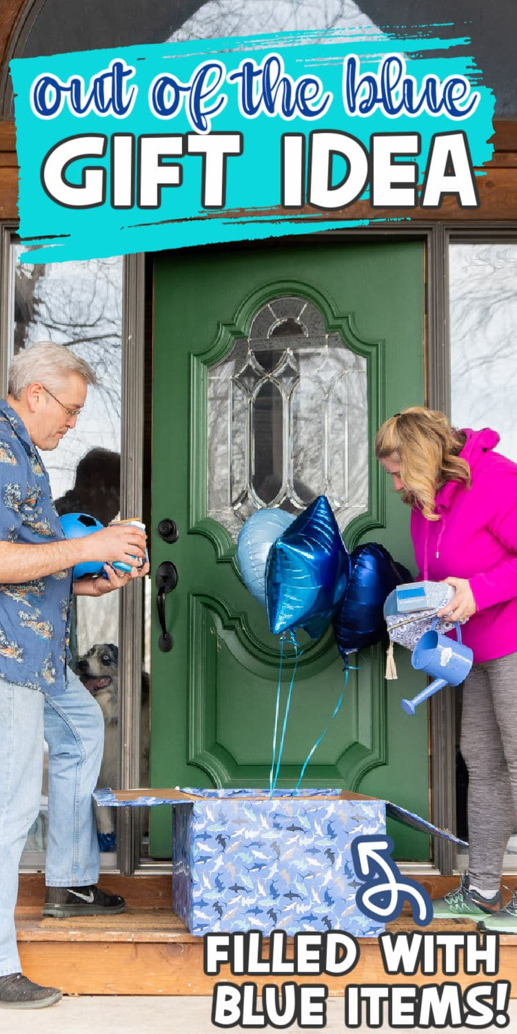 Two adults opening a wrapped gift box with blue balloons