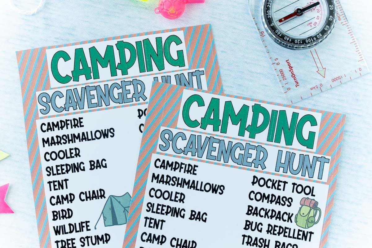 two copies of a camping scavenger hunt with a toy compass and whistle on a light blue background