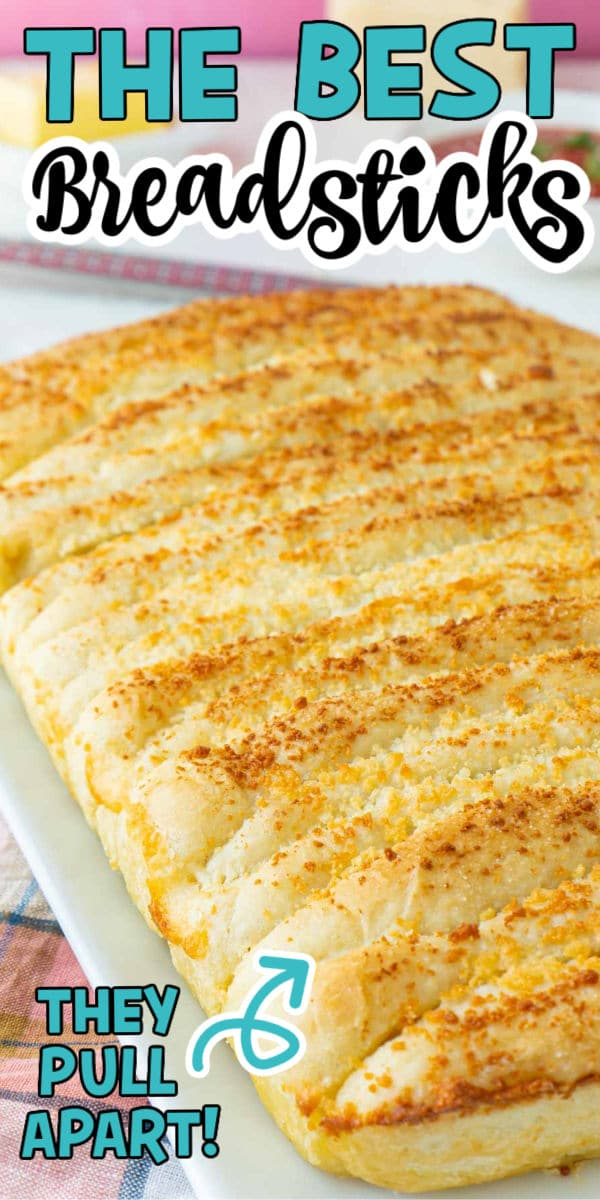 A plate with garlic breadsticks and text for Pinterest