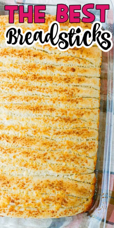 A glass pan full of garlic breadsticks with text for Pinterest