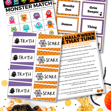 Printed out Halloween games in a pile on a white background