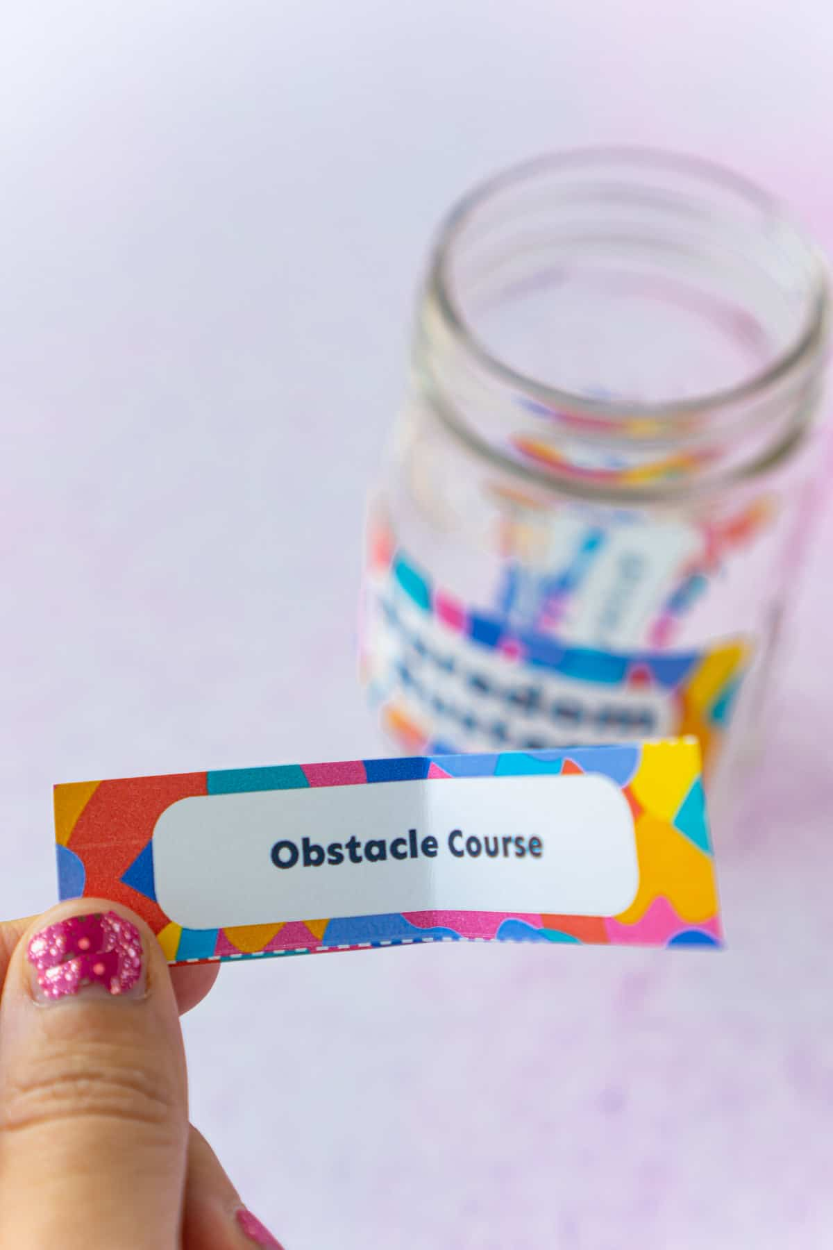 A woman's hand holding a piece of paper that says obstacle course