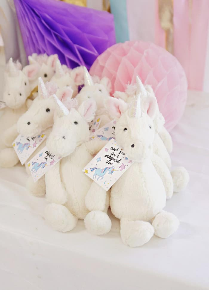 Plush unicorns with gift tags