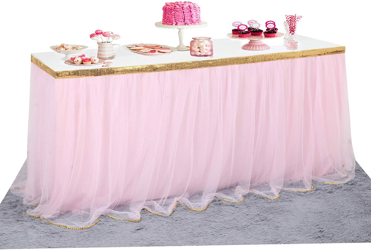 a pink tulle table skirt with pink items on the table