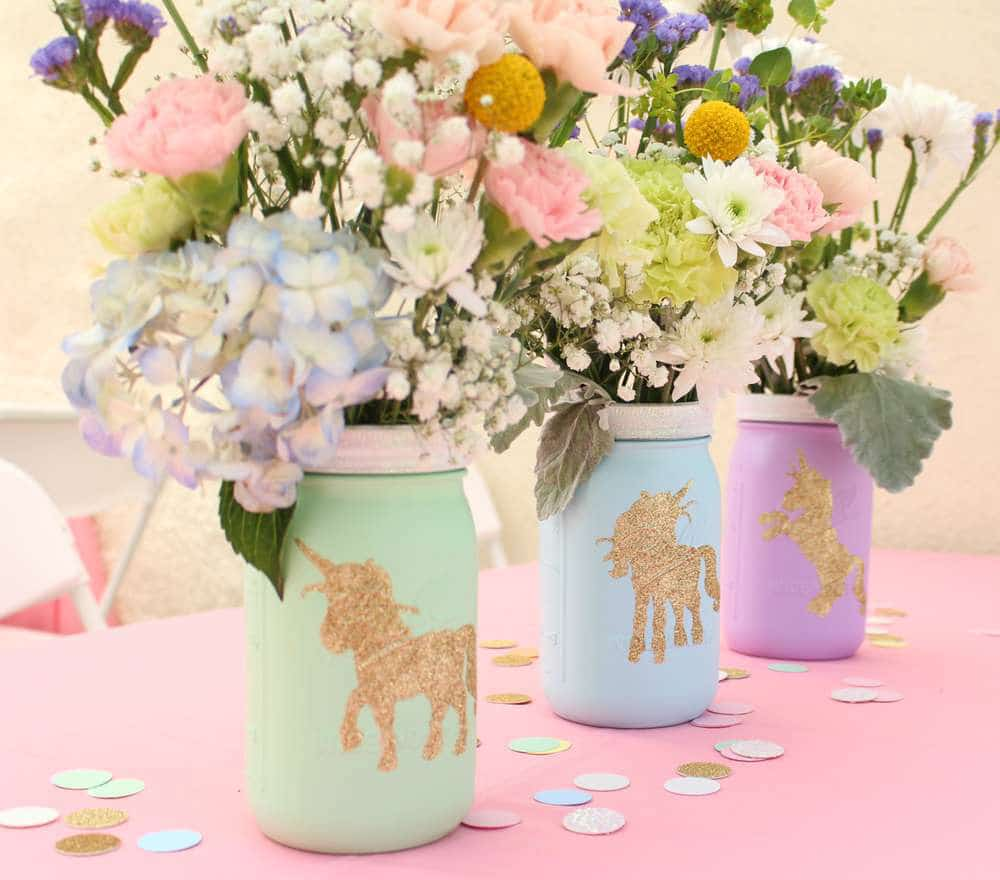unicorn print vases with flowers in them