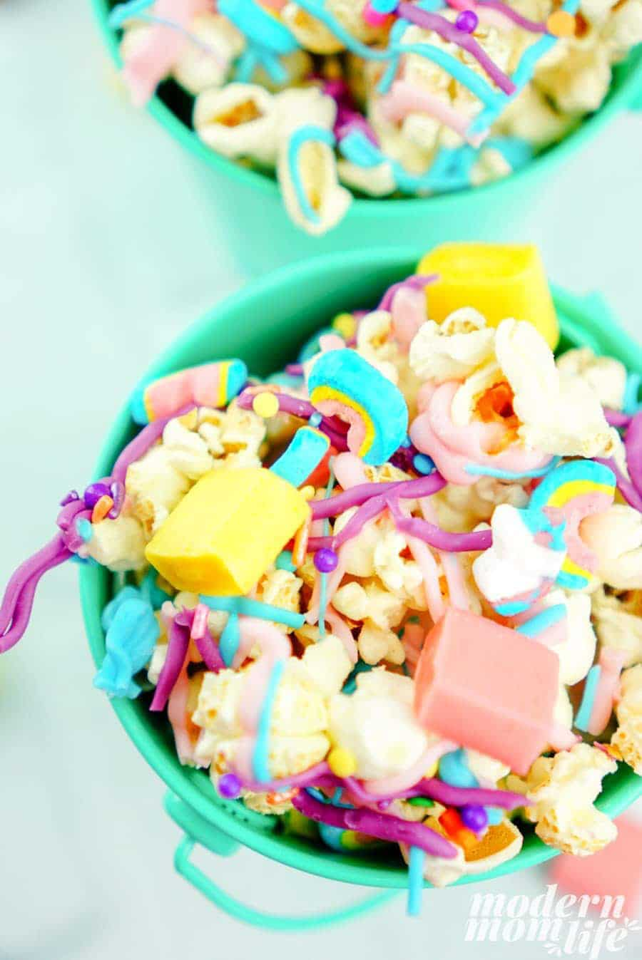 Green bucket filled with colorful unicorn popcorn snack