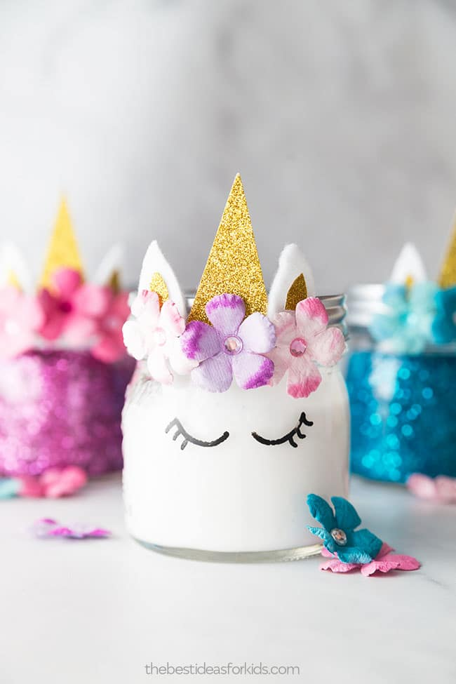 White unicorn decorated jar of slime with other colors in the background