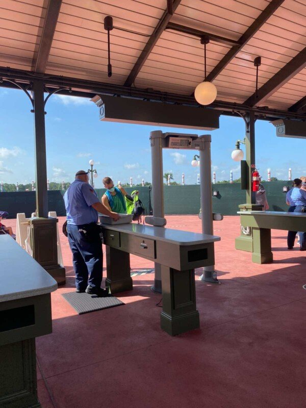 Man going through metal detector check at Disney World