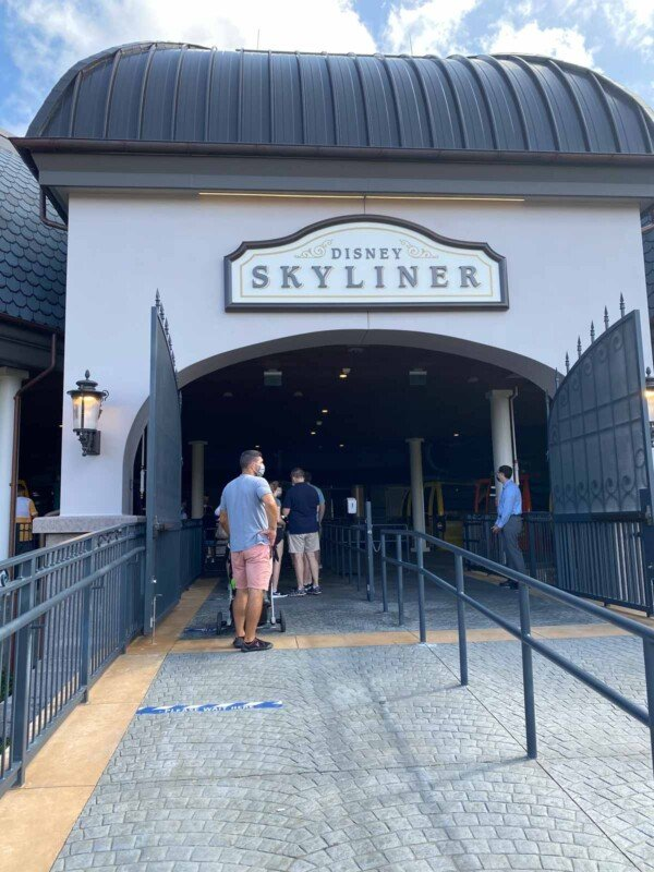Man standing in line for Disney's skyliner