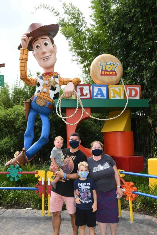 A family with masks at Disney's Toy Story Land