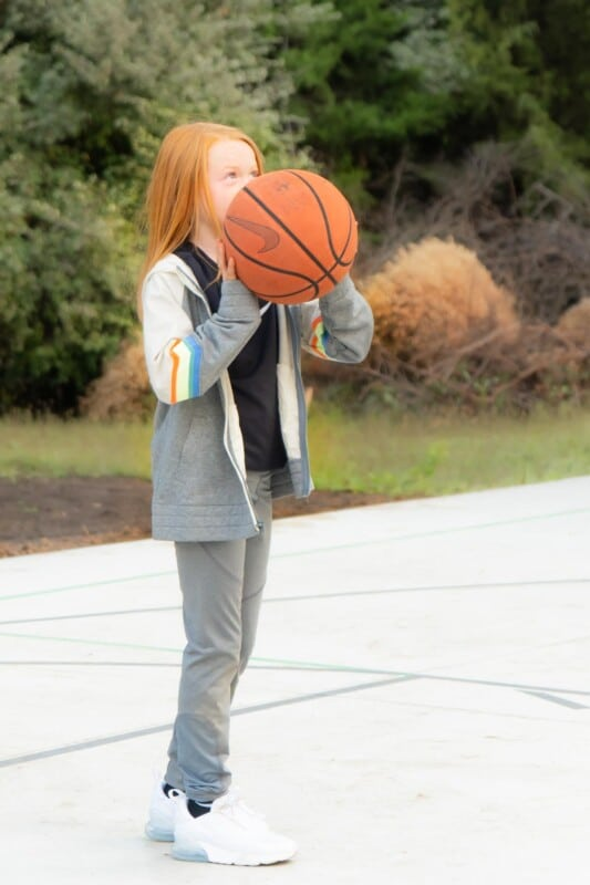 Girl holding a Nike basketball