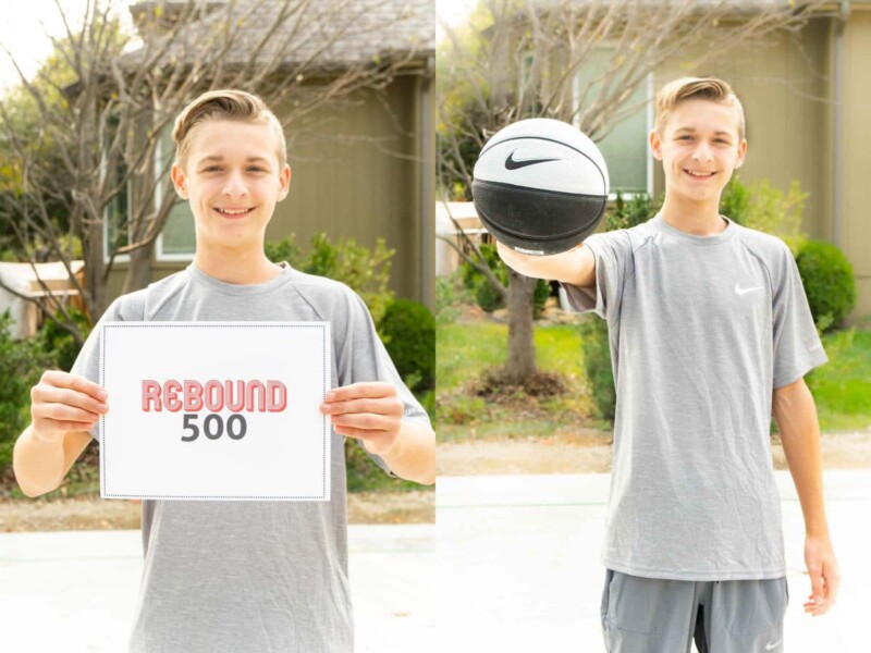 Boy in gray clothing holding a sign that says Rebound 500