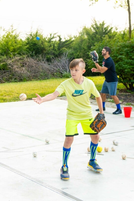 Kid in yellow clothes fielding a baseball