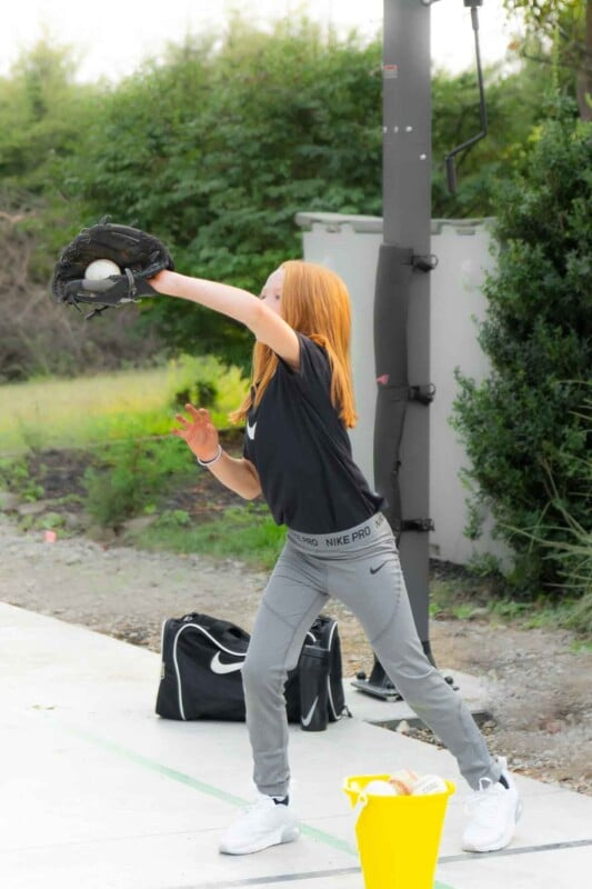 Girl catching a baseball in a glove