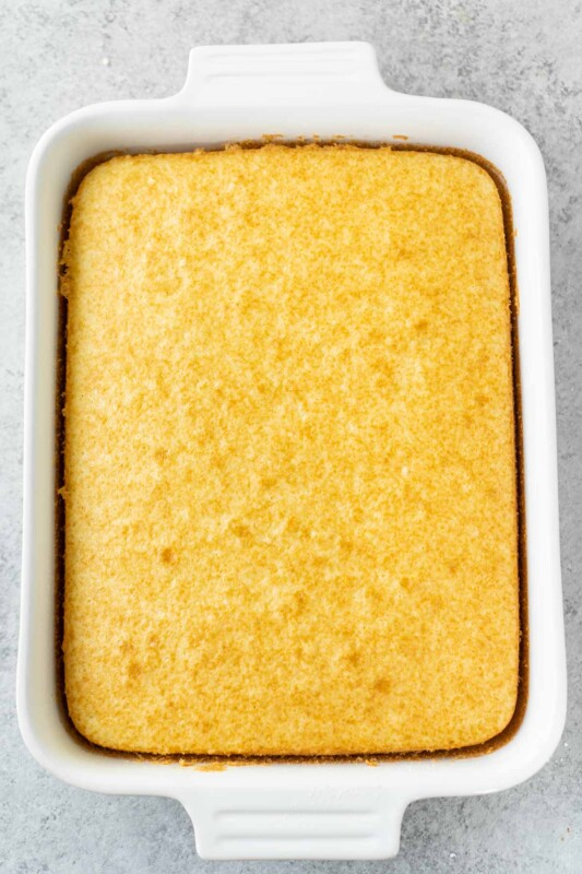 White cake in a white rectangle dish