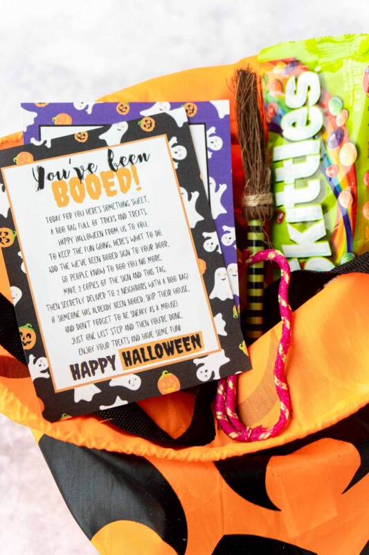 You've been booed sign on a pumpkin bag with Halloween candy