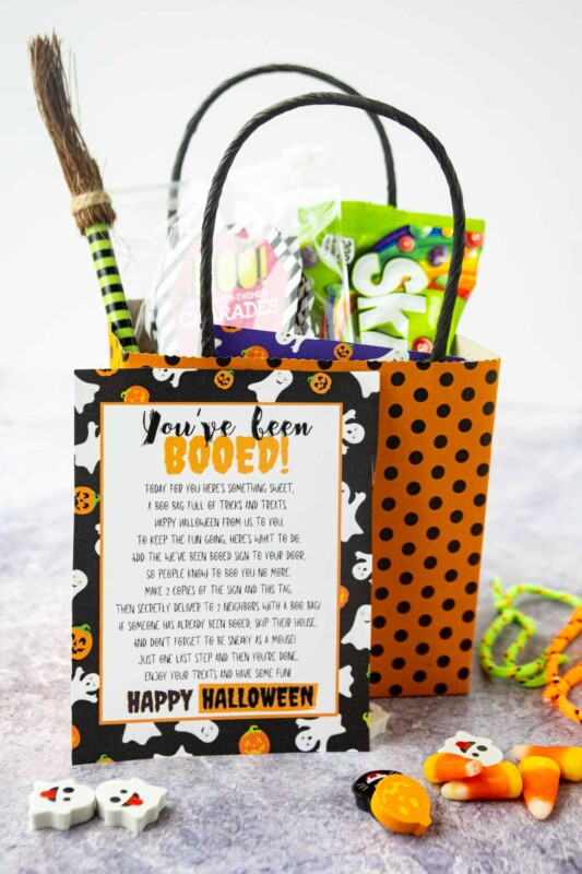 Black and orange polka dotted bag with a you've been booed sign and treats