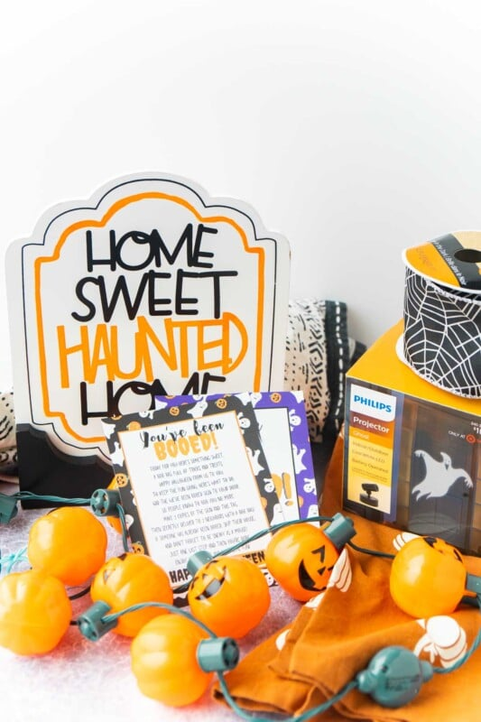 Home sweet haunted home sign, pumpkin lights, and a you've been booed sign
