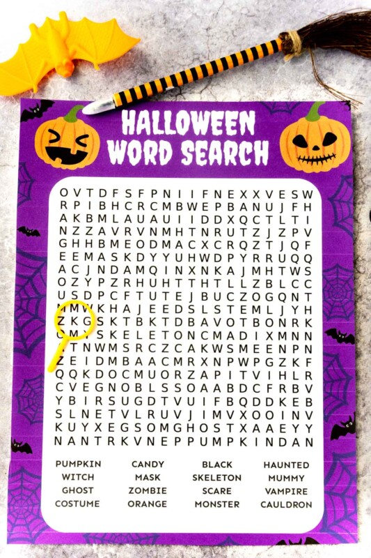 Printed out Halloween word search with a plastic bat and pen