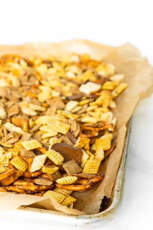 Baking sheet lined with parchment paper and topped with Chex Mix