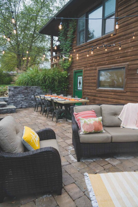 Chairs with fall colored pillows in an outdoor entertaining area