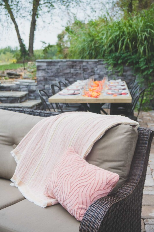 Blankets on a couch in an outdoor entertaining area