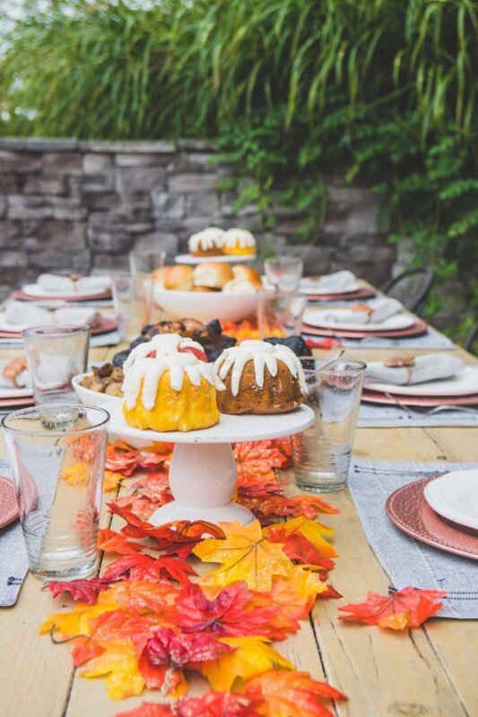 Fall table with fall colored bundt cakes