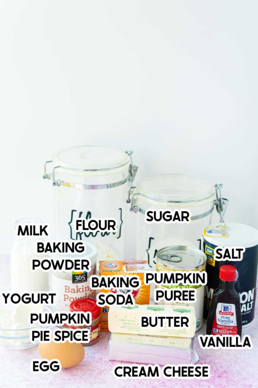 Ingredients needed to make pumpkin cream cheese muffins with labels