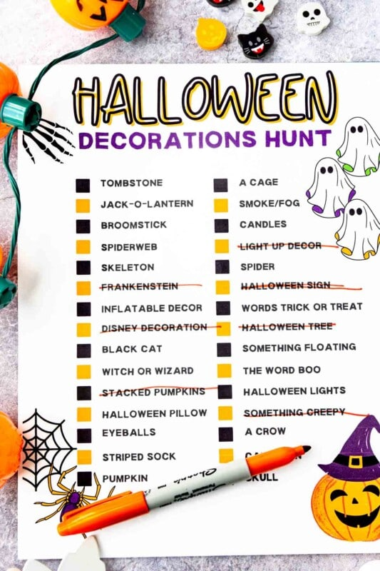 Printed out Halloween decorations hunt with Halloween items all around