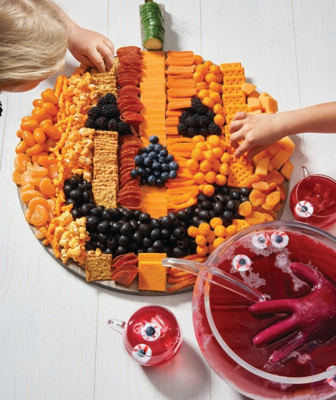 Pumpkin snack tray with a red Halloween punch