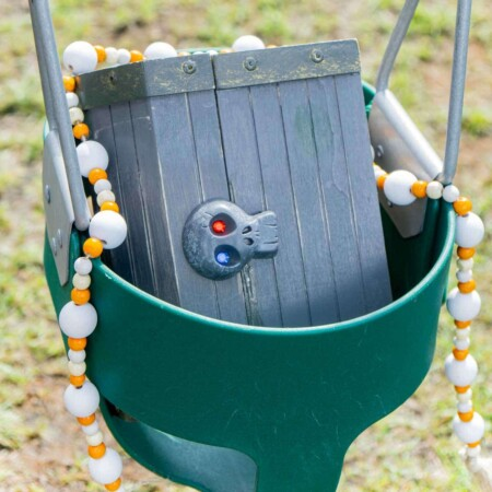 Treasure chest in a baby swing