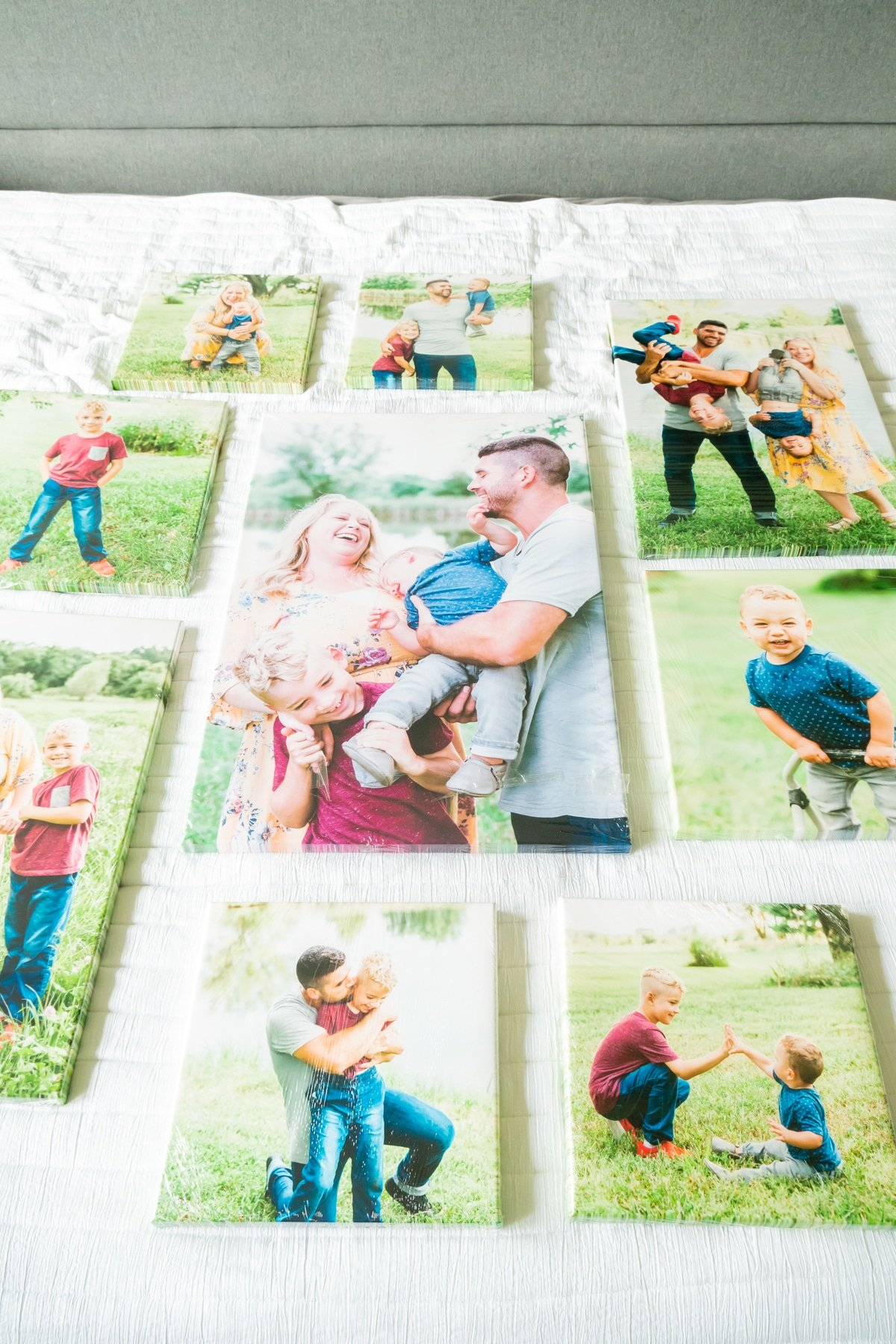 Photo canvases laid out on a bed